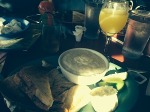 fish and grits and mimosa