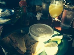 fish and grits and mimosa