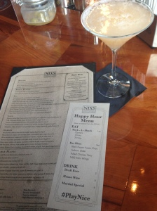cocktail with happy hour menu